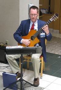 Photo of John Waldo performing on classical guitar